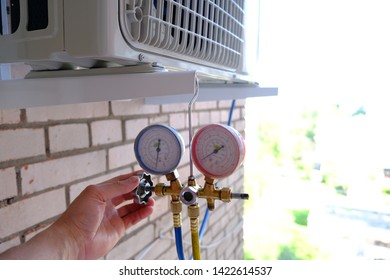 Manometers on equipment for filling automotive air conditioners. - Shutterstock ID 1422614537