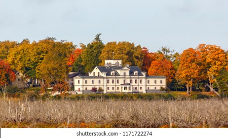 Manor house with trees in autumn colors