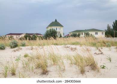 Manor on the sea beach on a cloudy day