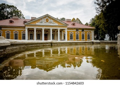 Manor in the village Samchiky Starokostyantinivsky raion, Ukraine. Building in the style of classicism. Reflection of the building in water