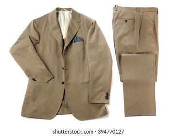 Mans beige suit with neatly folded pants and jacket with a handkerchief in the pocket isolated on white
