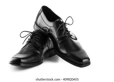 mans black leather shoes on white background