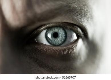 Mans blue eye close up