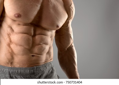 Man's body part, showing perfect ripped abs.