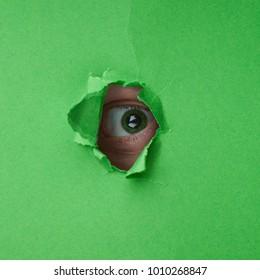The man's eye looks through the hole.