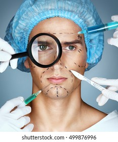 Man's face and beautician hands with syringes and scalpels near his face. Surgical mark lines on eyes, nose, cheek, and jaw. Plastic Surgery concept