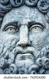Man's face stone sculpture