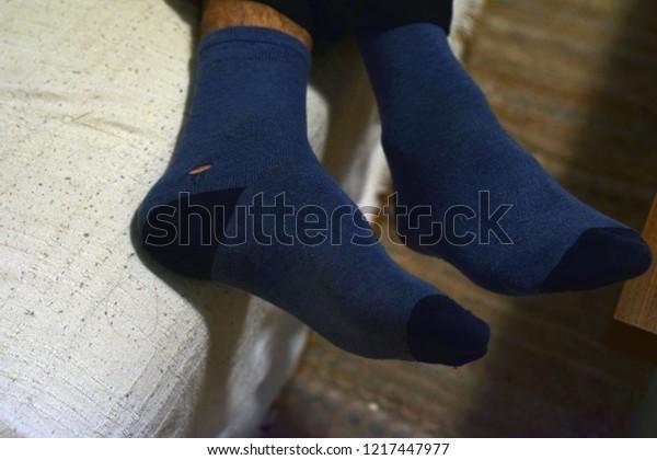 Mans Feet Blue Socks Hole One Stock Photo Edit Now 1217447977