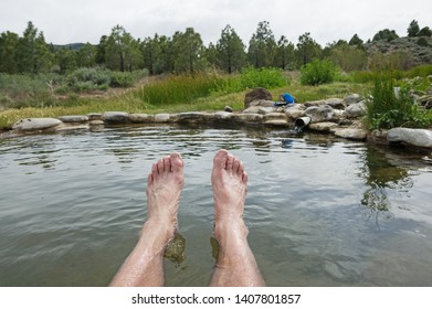 mans feet soaking in a hot spring in Northern California