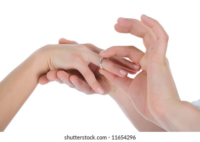 Man's and female hands with a wedding ring on the white