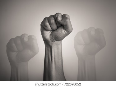 Man's fist in the air.  Revolution, protest, people, power, worker strike, election movement. Fight for your right!