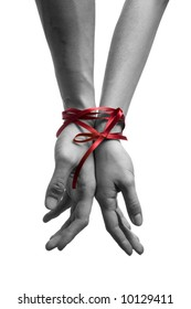 mans and  girls hands tieing with ribbon