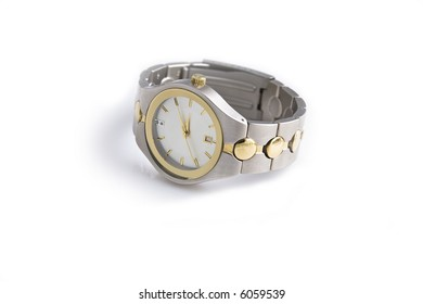 Man's gold and silver wrist watch on a white background.