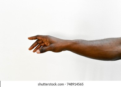 Man's hand. African right hand dark skin arm reaching on isolated white background