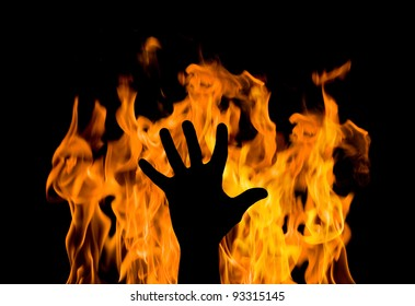 man's hand against the fire. gesture of support