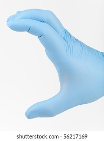 A man's hand in a blue latex glove. Hand is held open as if picking something up.