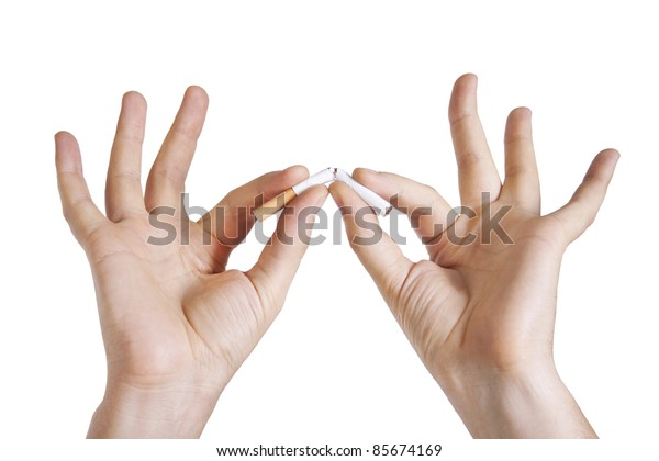 Man's hand breaking cigarette on white background