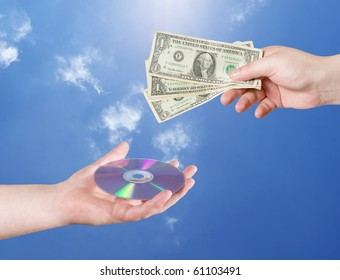 Man's hand with dollars and CD isolated