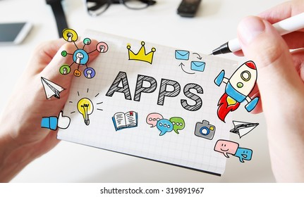 Mans hand drawing APPS concept on white notebook