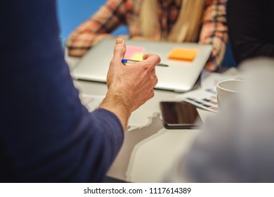 Mans hand in explaining gesture while in the office meeting