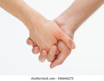 Man's hand gently holding woman's hand - closeup shot