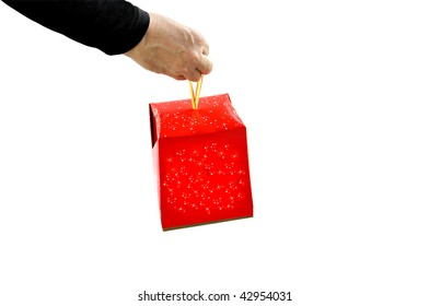 The man's hand with a gift box isolated over white. Can be used in various themes - celebration of Christmas, New Year, birthday, other events.