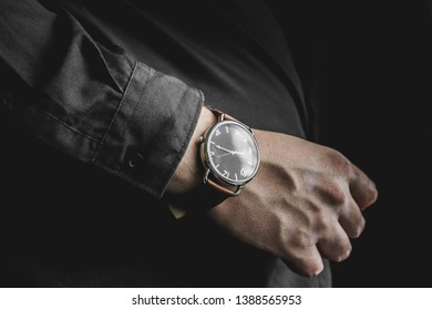 Man's hand with his watch showing