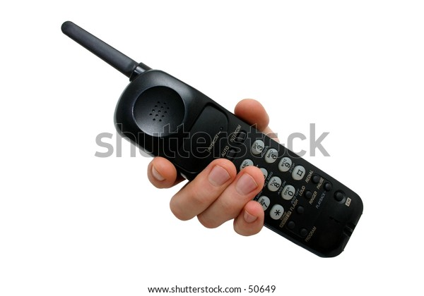 Man's hand holding a black cordless telephone isolated on white.