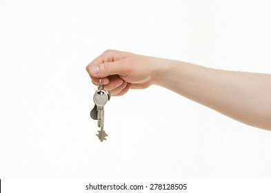 Man's hand holding a bunch of keys, white background