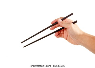 man's hand holding chopsticks isolated on white