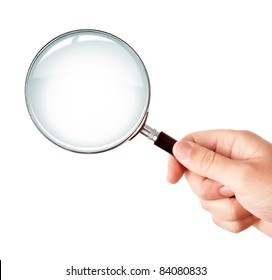 Man's hand, holding classic styled magnifying glass, closeup isolated on white background, copy space for your image or text