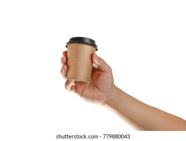 Man's hand holding craft empty paper coffee cup with a black plastic cap isolated on a white background.