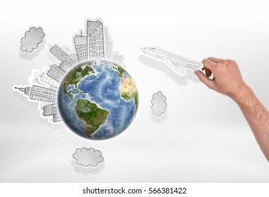Man's hand holding drawn airplane over globe with city sketches. Environmental pollution. Anthropogenic impact. Influence on the environment. Elements of this image are furnished by NASA.