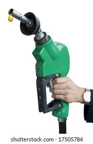 A man's hand holding a dripping gas pump