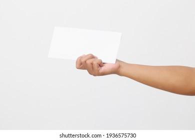Man's hand holding envelope isolated on white background. Close up