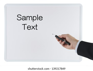 Man's Hand Holding a Felt Tip Marker and Pointing to a White Dry Erase Board with a Clipping Path for the Background