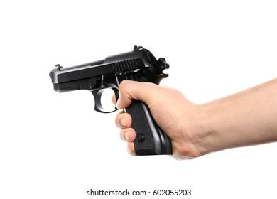 Man's hand holding gun on white background