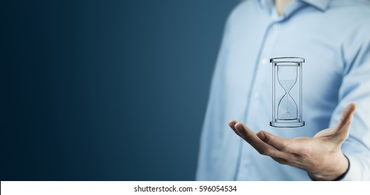 Man's hand holding hourglass sand in screen