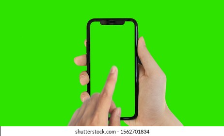 man's hand holding phone a mobile telephone with a vertical green screen in tram chroma key smartphone technology cell phone touch message display hand with luma white and black key