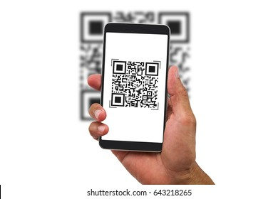 Man's hand holding smartphone scanning QR code on white background, business concept