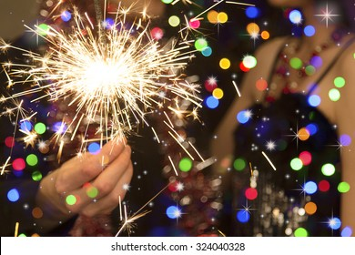 man's hand holding a sparkler during christmas