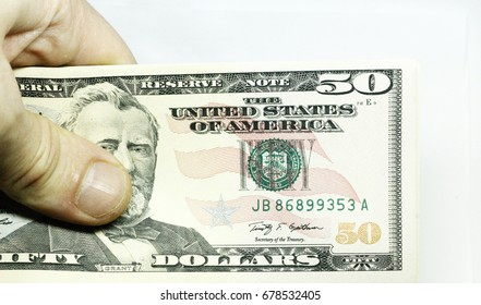 Mans Hand Holding A Stacks Of Paper Dollars Usa On The White Background