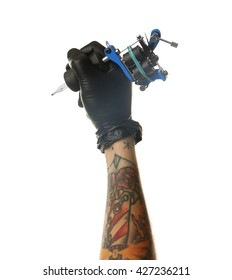 Man's hand holding tattoo machine on white background