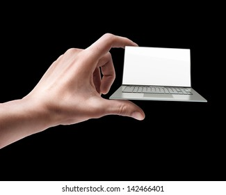Man's hand holding thin laptop with screen isolated on black background