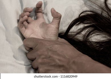 man's hand holding a woman hand for rape and sexual abuse concept, anti-trafficking and stopping violence against women,