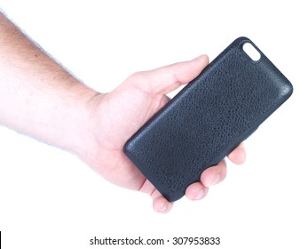 Man`s hand holds black iphone battery case isolated