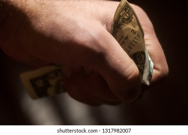Man's hand holds a dollar in his hand.Concept of waiver of the dollar.Financial crisis concept.