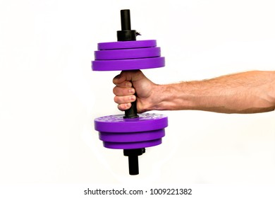 A man's hand holds a dumbbell of purple on a white isolated background