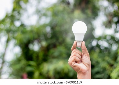 A man's hand holds a led light-emitting diode, an electronic energy-saving device that is the solution to future energy problems.
