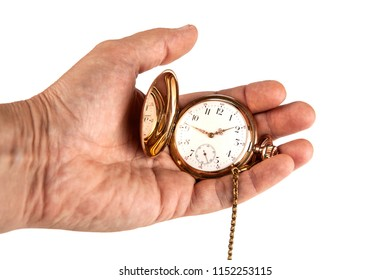 man's hand holds a vintage gold pocket watch on a white backgroundclose up